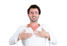 Handsome surprised young man with hands on chest Stock Photography