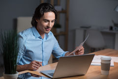 Handsome surprised young man working on laptop. Stock Photography