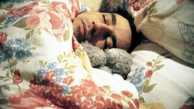 Handsome sweetheart man sleeping with plush toy, sensitive spinless tenderness loneliness, soft character. Video stock video footage