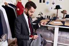 Handsome Tailor Making Jacket in Atelier Stock Photo