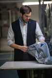Handsome tailor man Stock Images