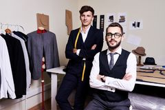 Handsome Tailors  in Modern Atelier Royalty Free Stock Photos