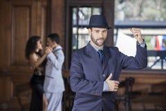 Handsome Tango Dancer Performing In Restaurant. Portrait of confident handsome tango dancer performing in restaurant Royalty Free Stock Photo