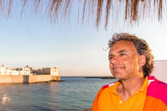 Handsome tanned relaxed man on holiday in Italy Stock Photos