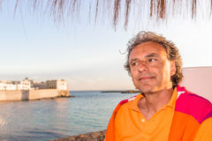 Handsome tanned relaxed man on holiday in Italy Stock Photo