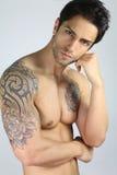 Handsome tattooed man Stock Image