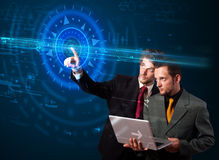 Handsome tech guys pressing high technology control panel screen Royalty Free Stock Photo