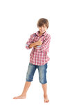 Handsome teen boy. Cute teen boy wearing a plaid shirt and denim shorts, shows the sign Excellent Stock Photography