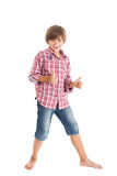 Handsome teen boy. Cute teen boy wearing a plaid shirt and denim shorts, shows the sign 'Excellent Stock Images