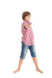 Handsome teen boy. Cute teen boy wearing a plaid shirt and denim shorts, showing a finger on Stock Image