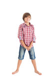 Handsome teen boy. Cute teen boy wearing a plaid shirt and denim shorts, smiling face Royalty Free Stock Photos