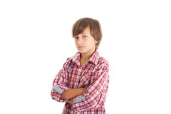 Handsome teen boy. Cute teen boy wearing a plaid shirt. The boy crossed his arms over his chest Stock Photos