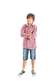 Handsome teen boy. Cute teen boy wearing a plaid shirt. The boy crossed his arms over his chest Stock Photography