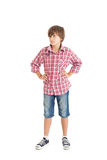 Handsome teen boy. Cute teen boy wearing a plaid shirt. The boy put his hands on his belt Royalty Free Stock Images