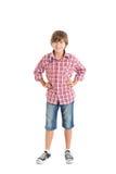 Handsome teen boy. Cute teen boy wearing a plaid shirt. The boy put his hands on his belt Royalty Free Stock Photos