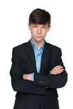 Handsome teen boy in a black suit. A portrait of a handsome teen boy in a black suit on the white background Royalty Free Stock Images