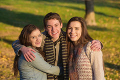 Handsome Teen Boy with Girls. Smiling handsome teen male with happy girlfriends outdoors Stock Photos
