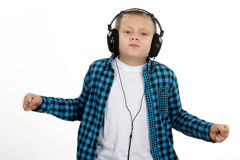 Handsome Teen Boy With headphones on head listenin. Handsome Teen Boy With headphones on head dancing and listening to music Stock Photo