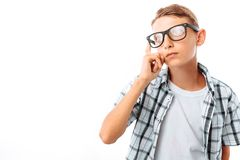 Handsome teen boy straightens glasses, male nerd in Studio on white background stock photos