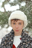Handsome teen boy in white fur hat Stock Image