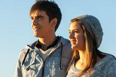 Handsome teen couple looking in the distance. Royalty Free Stock Photos
