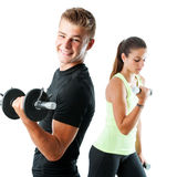 Handsome teen couple working out with weights. Stock Image