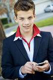 Handsome teen with phone Royalty Free Stock Photography