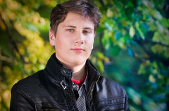 Handsome Teen Portrait In Autumn Leaves Background Royalty Free Stock Image