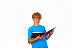 Handsome teen, reading Stock Photography