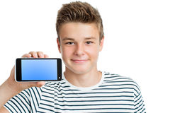 Handsome teen showing smart phone with blank screen. Stock Photo