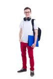 Handsome teenage boy with backpack and headphones isolated on wh Royalty Free Stock Image