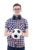 Handsome teenage boy with headphones and soccer ball  on Royalty Free Stock Photos