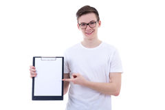 Handsome teenage boy holding clipboard with copy space isolated Royalty Free Stock Photo