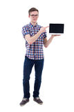 Handsome teenage boy holding laptop with blank screen isolated o Royalty Free Stock Photos