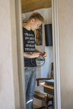 Handsome teenage boy holding some cables Royalty Free Stock Photography
