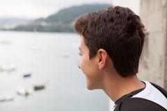 Handsome teenage boy he is looking straight ahead Royalty Free Stock Image
