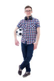 Handsome teenage boy posing with soccer ball isolated on white Stock Photo