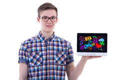 Handsome teenage boy showing laptop with media icons and applica. Tions isolated on white background Royalty Free Stock Photos