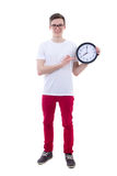 Handsome teenage boy showing office clock isolated on white Royalty Free Stock Photos