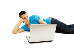 Handsome teenage boy using laptop Stock Images