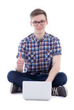 Handsome teenage boy using laptop and thumbs up isolated on whit Stock Photo
