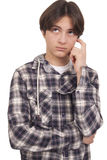 Handsome teenage thinking Stock Images