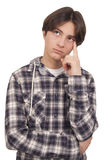 Handsome teenage thinking Royalty Free Stock Photos