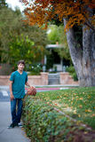 Handsome Teenager with Basketball Royalty Free Stock Image