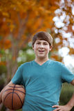 Handsome Teenager with Basketball Royalty Free Stock Photography