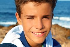 Handsome teenager boy closeup smiling beach Royalty Free Stock Images