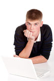 Handsome teenager boy student with laptop Royalty Free Stock Photography