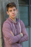 Handsome teenager in casual clothes. Portrait of handsome teenager in casual clothes leaning against building outdoors royalty free stock photos