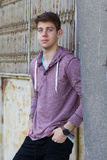 Handsome teenager in casual clothes. Portrait of handsome teenager in casual clothes leaning against building outdoors stock images