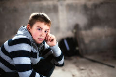 Handsome teenager looking self assured at camera Stock Photography